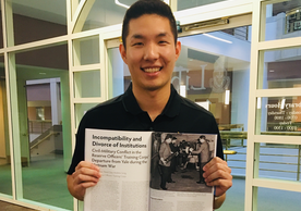 Andrew Song '22 pictured here with his essay at National Defense University's library at Fort McNair, Washington D.C.